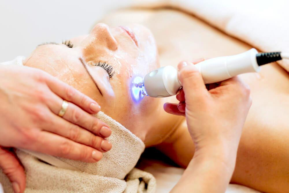 Woman undergoing laser and light skin therapy