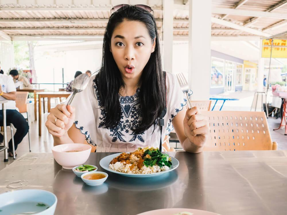 Surprised woman eating a meal