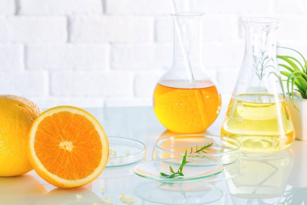 Citrus fruits and liquid in lab