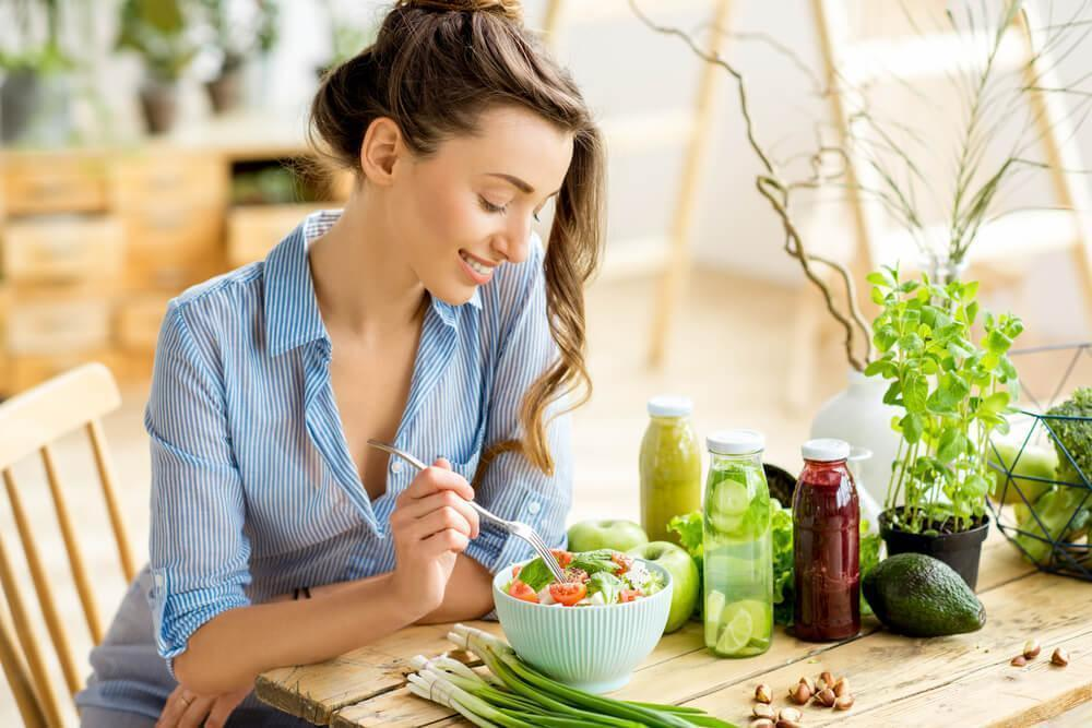 Woman eating healthy food at table