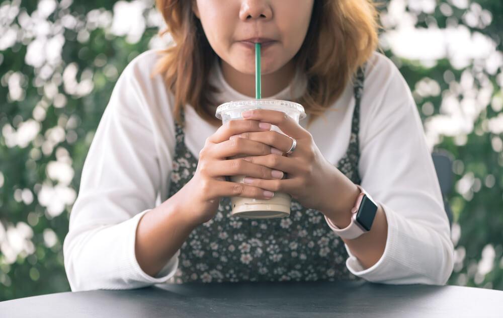 Woman drinking through straw