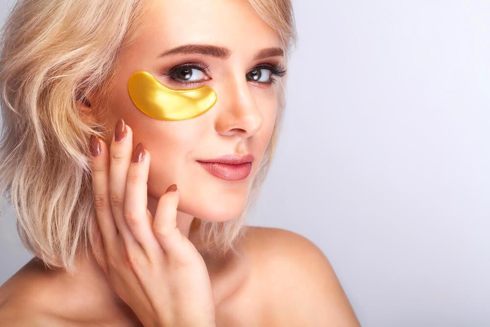 Woman with under-eye golden mask