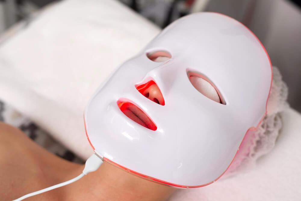 Unknown woman with facial LED device