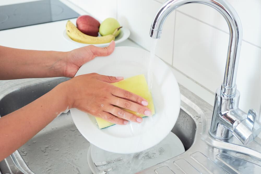 Washing dishes in the sink