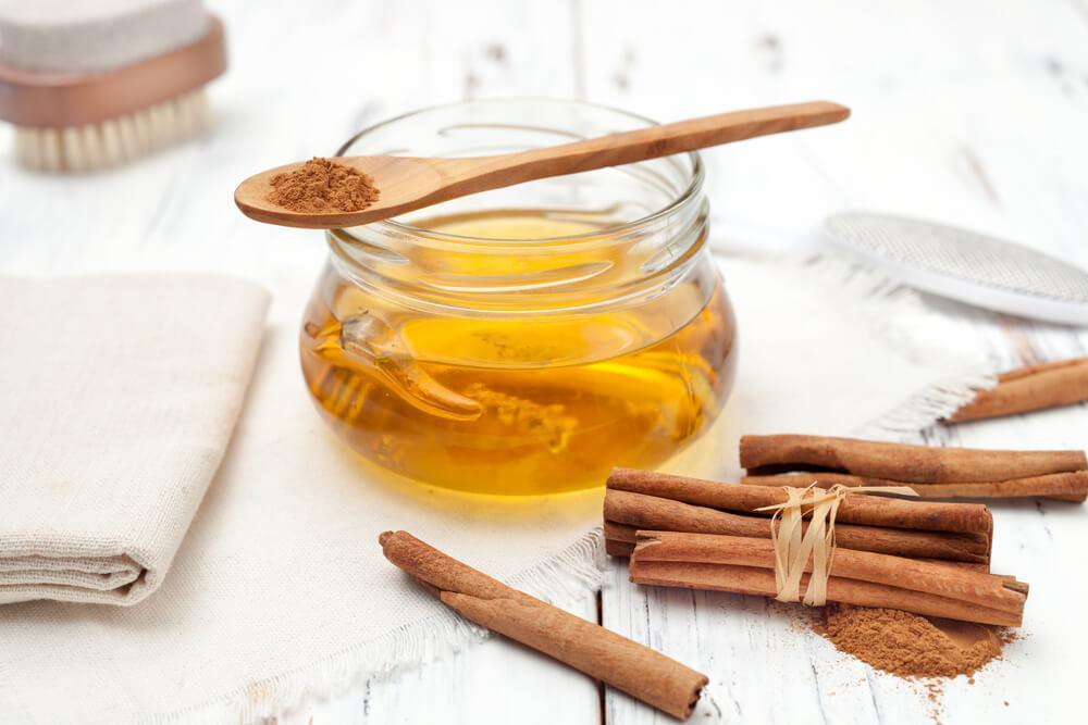 Honey in jar with cinnamon sticks