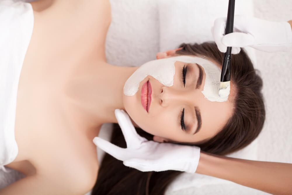 Woman facial treatment at spa