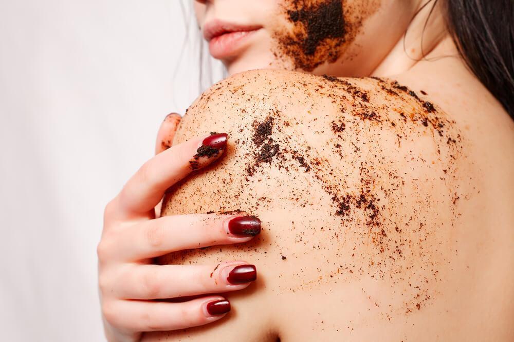 Woman using coffee scrub
