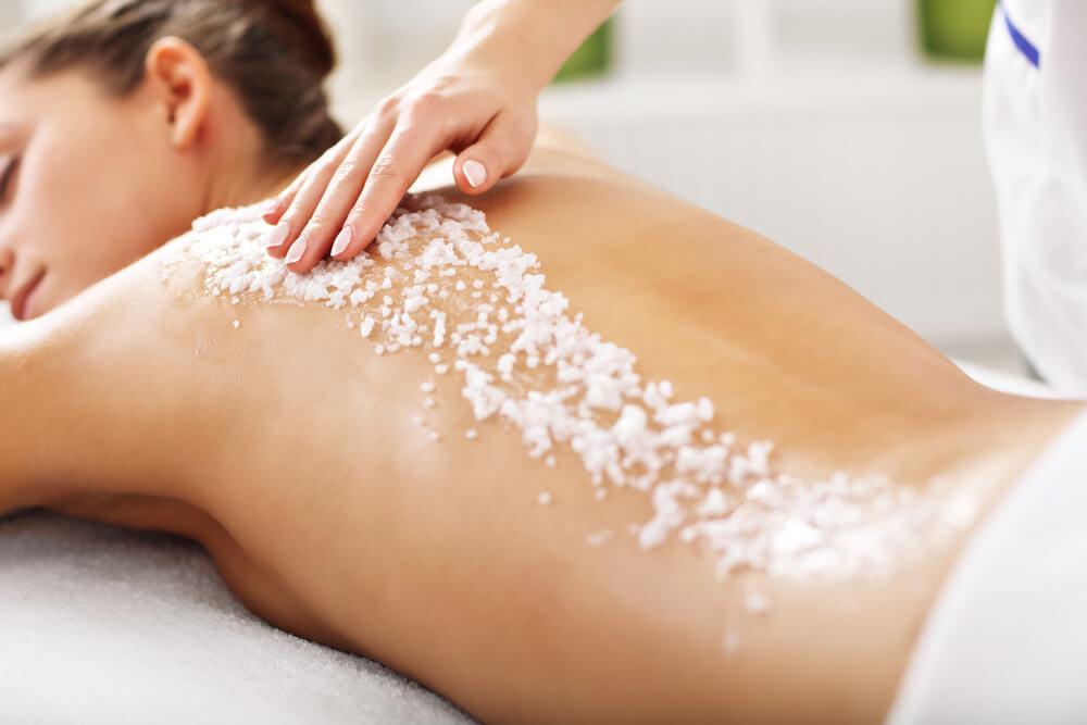 Sugar scrub on woman's back